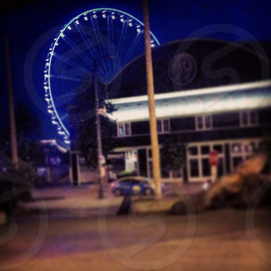 Great Ferris wheel evening at the pier photo