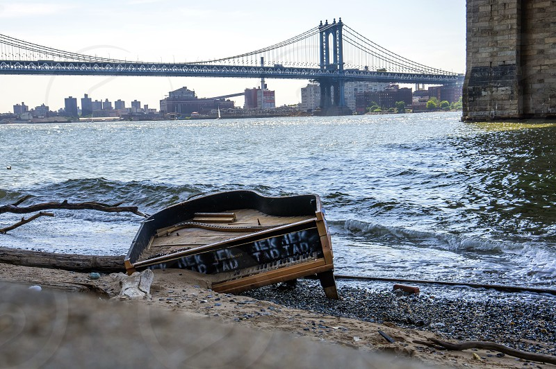 Sometimes interesting things wash up on the shore of Manhattan NYC like this piano.  photo