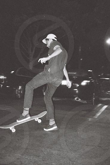 man with white cap skateboarding photo