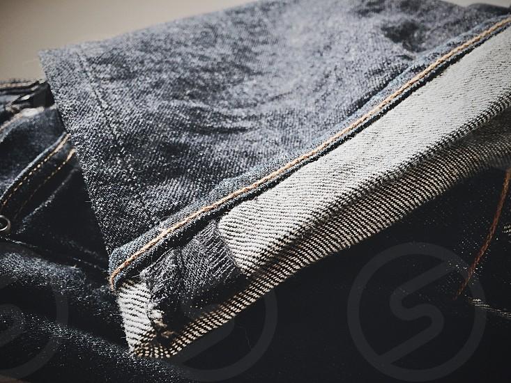 Folded blue jeans.  photo
