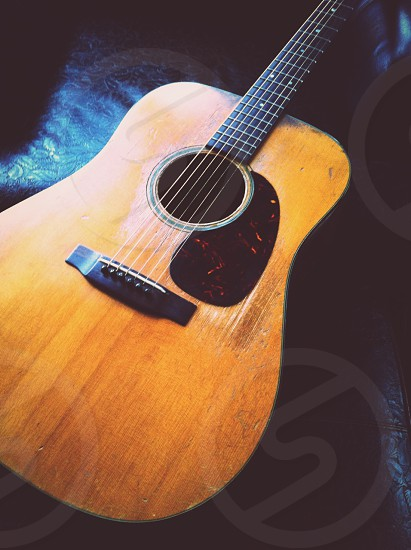 Wood Steel and Leather.  Vintage Martin D-18 Guitar. photo