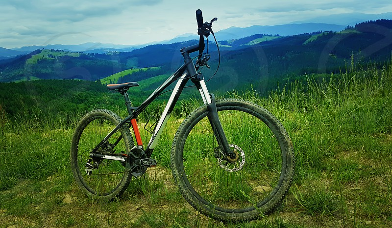 A bicycle over the moutains backround. Biking adventure and traveling symbol. Healthy lifestyle concept photo