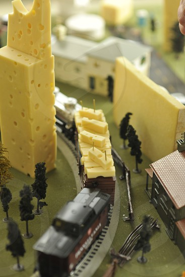 Various cheeses along with assorted toy models trains etc photo