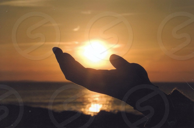 hands acting holding the sun photo