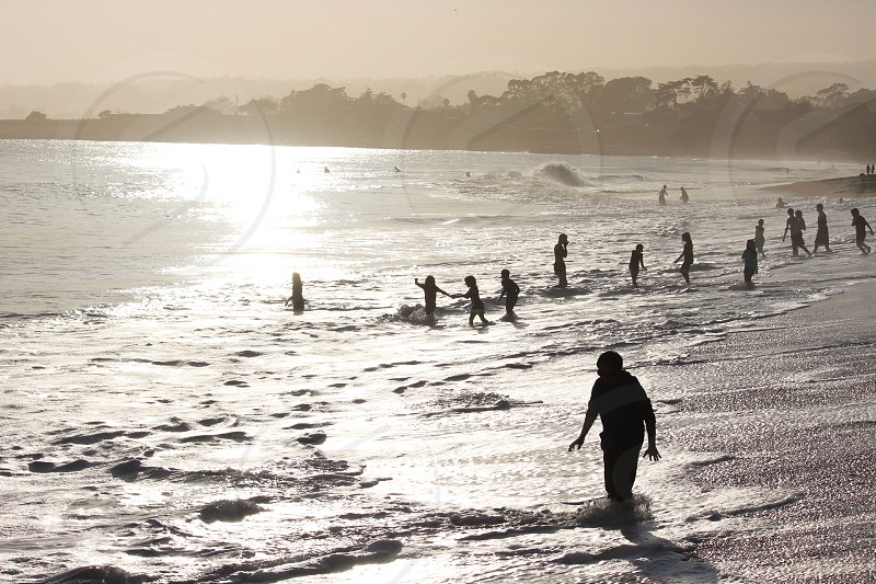 silhouette sun beach coast west santa cruz warm kids waves water shine summer photo