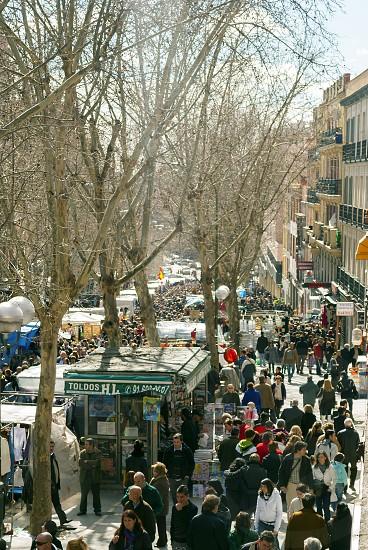Scene from El Rastro flea market in Madrid Spain. El Rastro is held in La Latina neighborhood every Sunday ant its the most important market in Madrid. photo