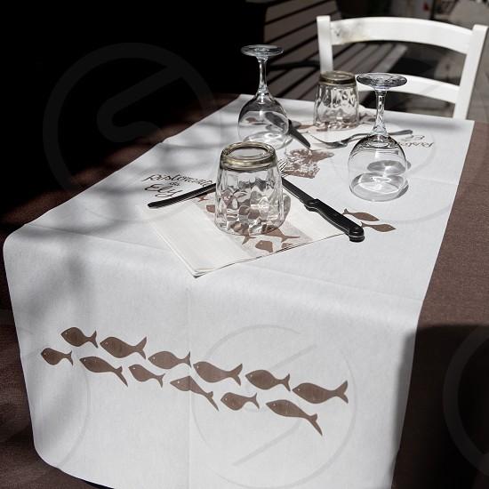 MONTEROSSO LIGURIA/ITALY  - APRIL 22 : Table laid for dinner in Monterosso Liguria Italy on April 22 2019 photo
