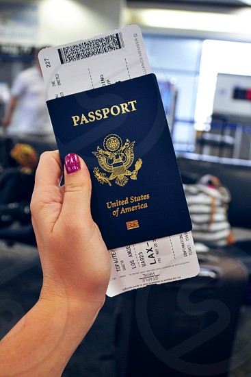 Passport and plane ticket in airport photo