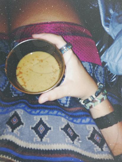 beige beverage in brown mug photo