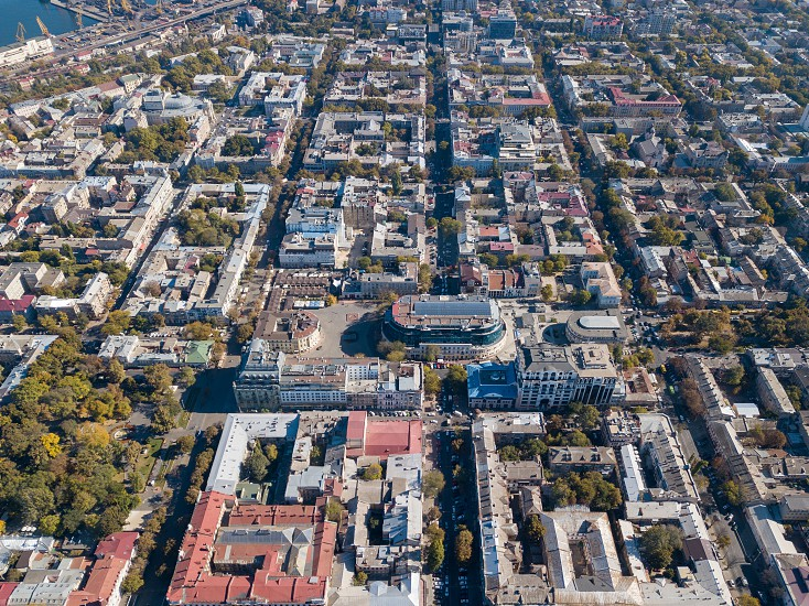 Aerial view of a drone on the city of Odessa with a shopping center streets with cars and buildings on a sunny summer day Ukraine. photo