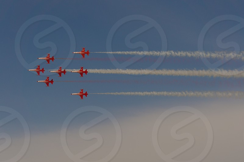 7 jets in the air performing at air show. photo