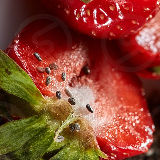 Fresh ripe red strawberry with close-up seeds and green leaves soft focus. Fruits background. Concept of healthy dieting food. photo