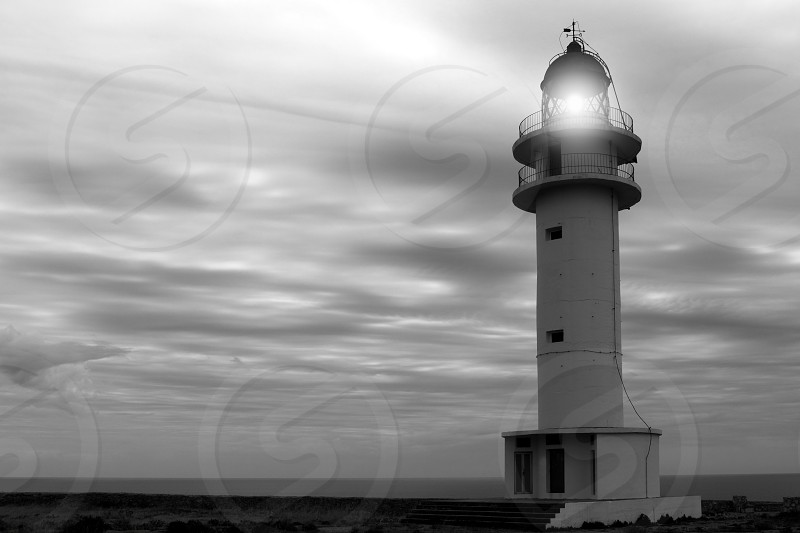 Barbaria cape lighthouse Formentera Balearic islands black and white photo
