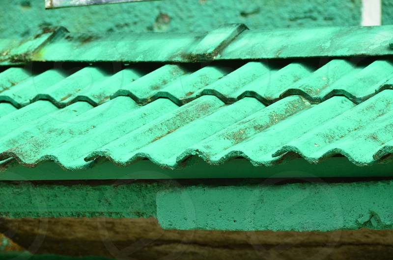 #green_curves #geometric_shapes #waves  Top of the roof of a small green house in Baños City Ecuador. photo