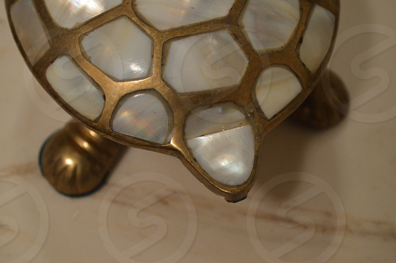 gold plated with white gemstones turtle ornament photo