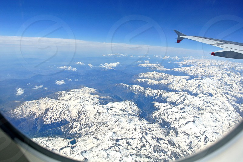 View of snow capped peaks from an aeroplane. photo