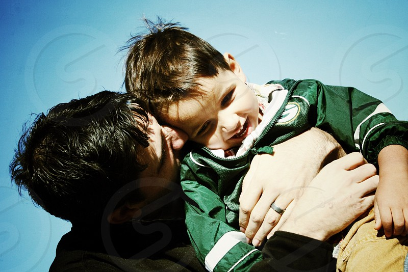 man carrying boy both smiling photograph photo