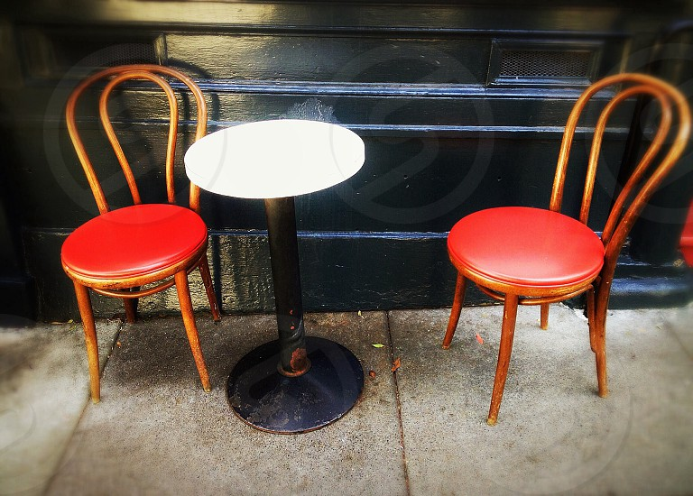 2 ice cream chairs near round table photo