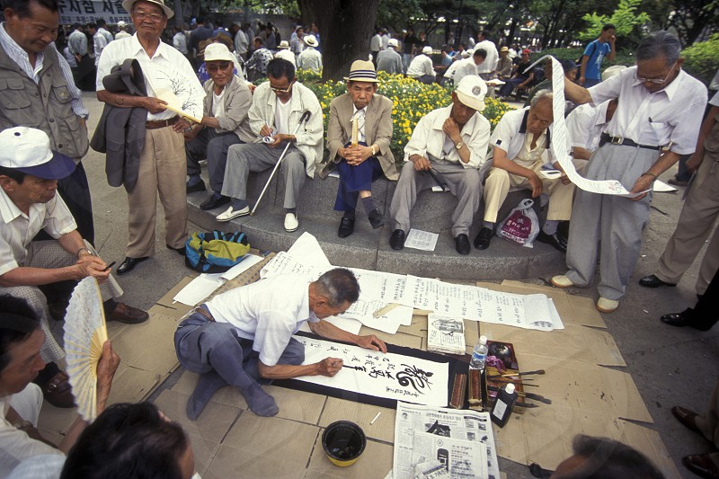seniors and a calligrapher at the Tapkol Prk in the city of Seoul in South Korea in EastAasia.  Southkorea Seoul May 2006 photo