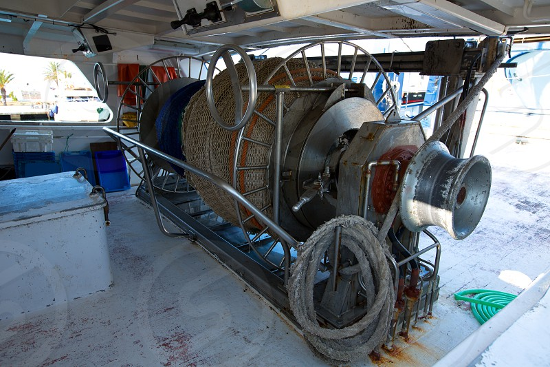 Fishing trawler boat engine motor huge winche on deck photo