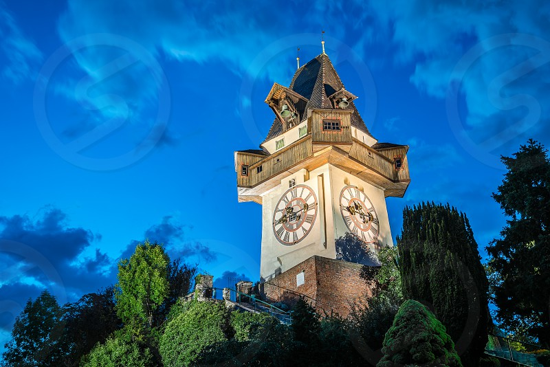The Schlossberg at night. It is a tree-clad hill and the site of a fortress in the centre of the city of Graz Austria. The hill is now a public park and enjoys extensive views of the city photo