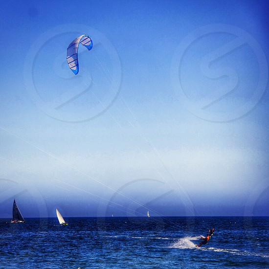 Another day on the water. Kitesurfing and sailboats photo