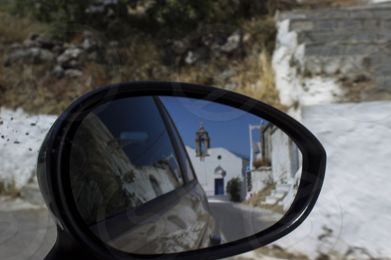 Road trip in Crete Island Greece. Mirror view of a Greek Church on a spring sunny day! photo