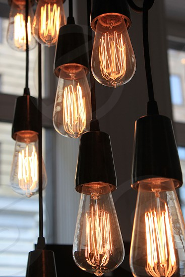 Edison Bulbs are a trend in many retail environments / old school lighting fixture photo