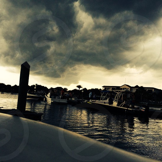 dark clouds and white boat photo