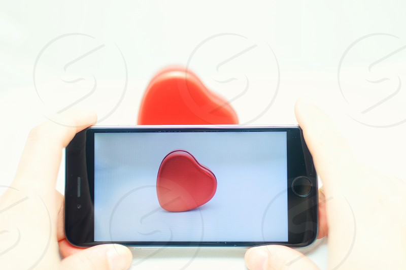 space grey iphone 6 with red heart on screen photo