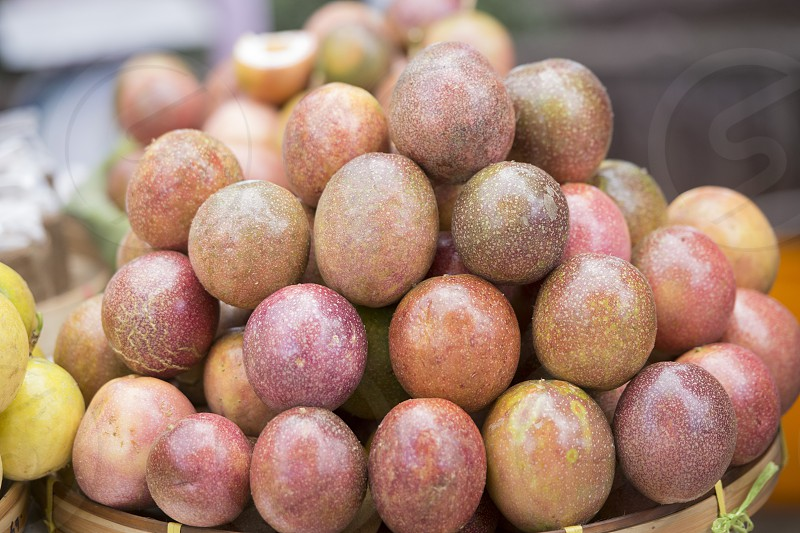 passionfruit or maracuja at a market in the city of Chiang Rai in North Thailand. photo