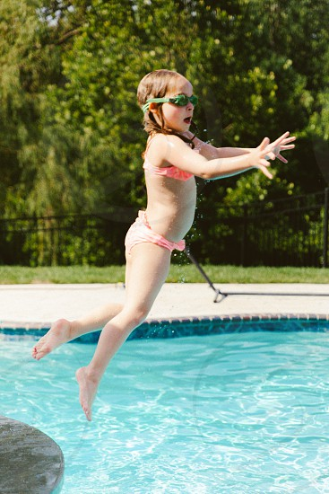 Niece jumping into pool  photo