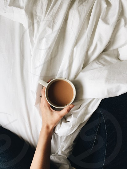 Tea mug bed keeping warm winter light white cozy hand photo
