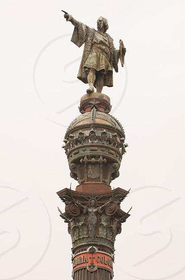 man wearing traditional dress statue photo
