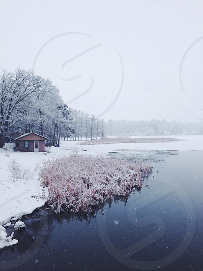river near snow field photo