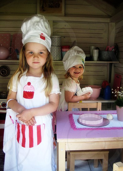 Sisters playing child kids chef cooking happy Sweden photo