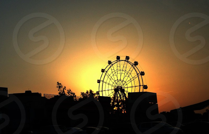 Carnival Ferries Wheel park fair dusk bright beautiful silhouette sunset sky photo