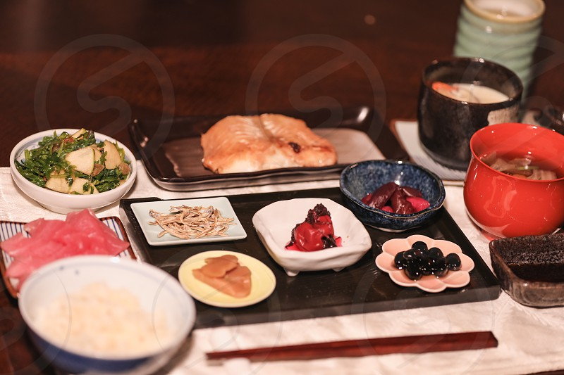 Homemade Japanese meal cuisine dinner international Japan authentic culture Asian food fish healthy soup sushi chopsticks traditional dining room home restaurant dinner lunch plates dish luxury photo