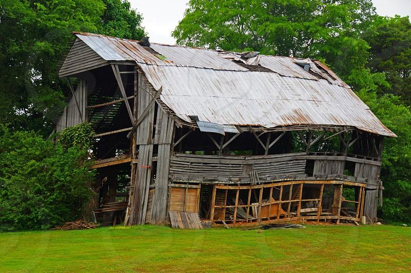wrecked house near green trees photography photo