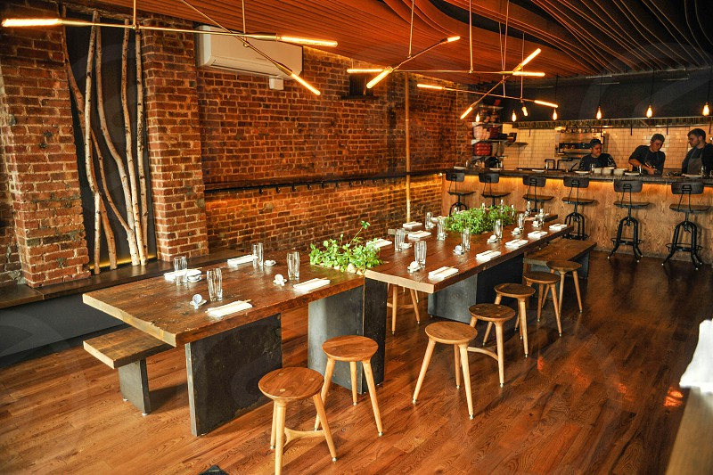 wooden table and bar stools photo