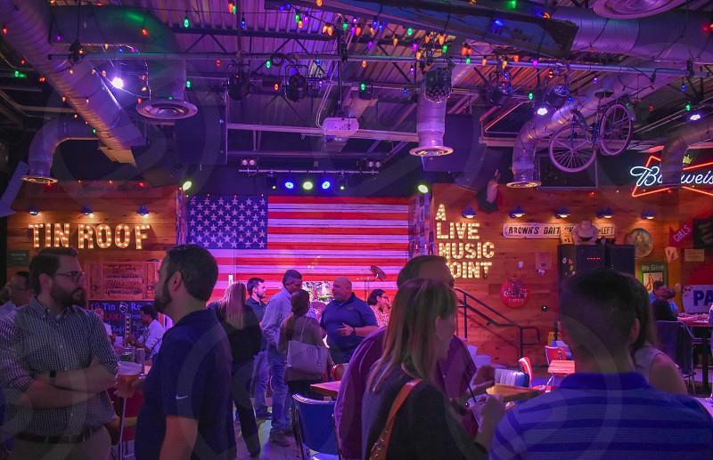 Orlando Florida. January 19  2019 . People enjoying midnight  in colorful american bar in International Drive area (1) photo
