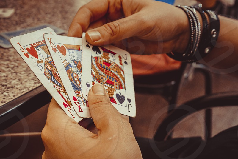 Hands using play cards photo