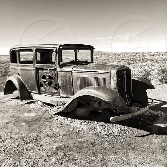 grayscale photography of vintage car chassis photo