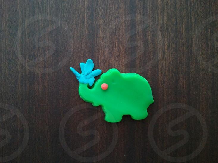 Elephant watering around photo