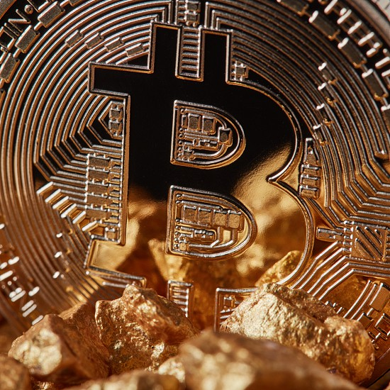 Marco shot of golden Bitcoin Coin and mound of gold. Bitcoin as desirable as digital gold concept or Concept of financing Bitcoin cryptocurrency in Noble metal photo