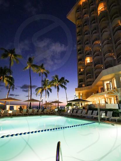 Luxury hotel pool during sunset Hawaii moana surfrider hotel photo