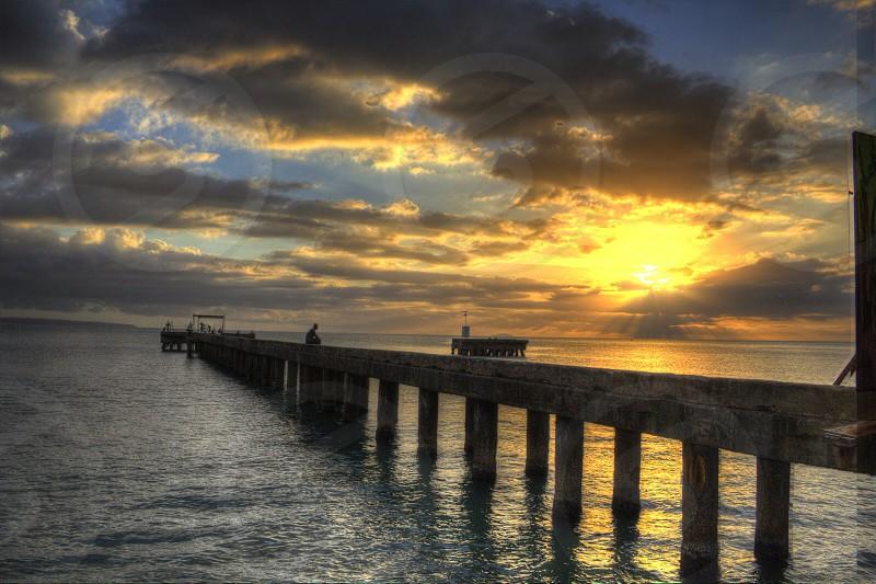 People on wooden port on dawn scene photo