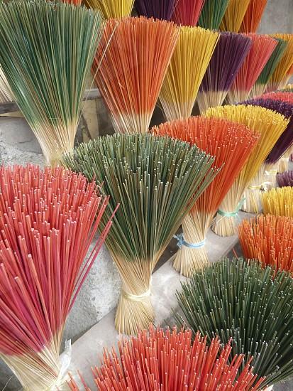 Rainbow of incense sticks. photo