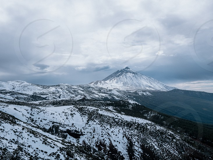 Winter mountains snow Vulcan volcano cold landscape hiking Teide canaryislands. photo