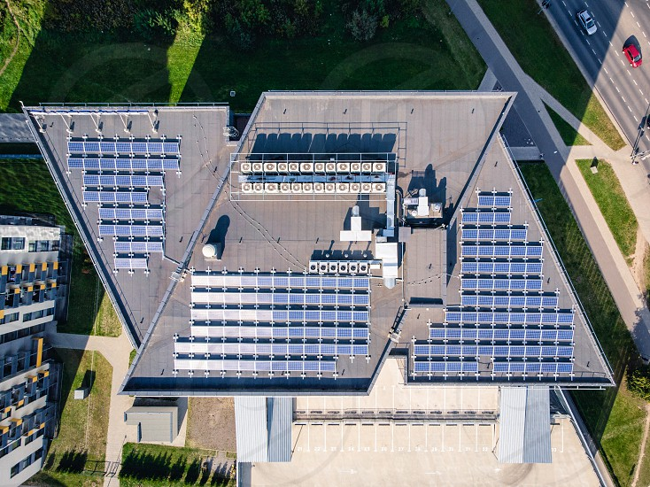 X shaped building with solar plant at the roof.  photo